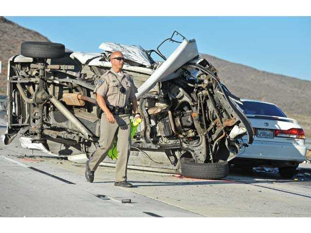 A California Highway Patrol officer investigates a multi-car pileup on northbound Highway 14 south of Escondido Canyon Road in Agua Dulce on Monday. Photo by Jonathan Pobre.
