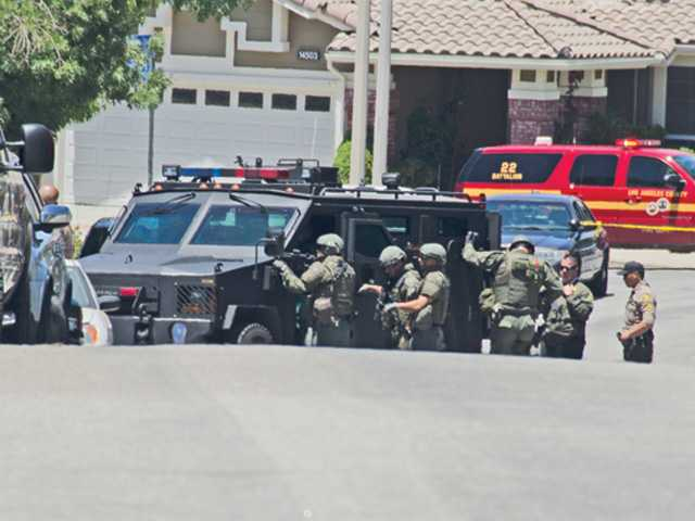 Neighbor Larold Rubhun sent in this photo of SWAT team members outside the Canyon Country home where a man was holed up today. Some neighbors were evacuated.