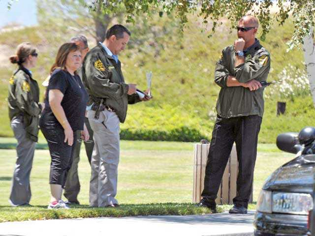 Sheriff's officials meet at a command post set up at Stonecrest Park in Canyon Country on Tuesday. Signal photo by Jonathan Pobre