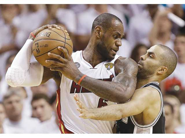 San Antonio Spurs guard Tony Parker, right, and Miami Heat forward LeBron James collide during Game 6 of the NBA Finals on Tuesday in Miami.