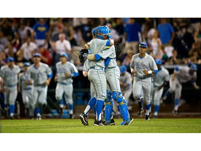 UCLA closing pitcher David Berg, left, hugs catcher and Valencia High graduate Shane Zeile following the Bruins' 2-1 victory over North Carolina State during a College World Series game in Omaha, Neb. on Tuesday.