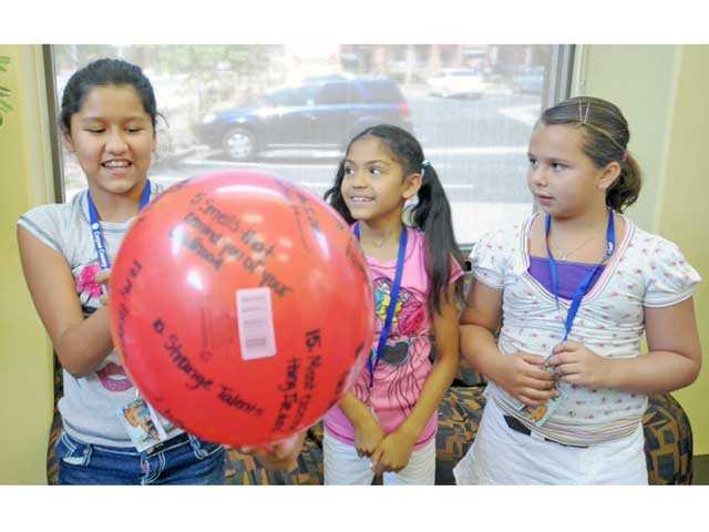 From left, Emily Yera, 10, answers a trivia question as Cherish Williams, 8, and Aayla Hovis, 8, participate in a team-building game as part of Summer Blast at the Canyon Country Community Center on Monday. Signal photo by Jonathan Pobre