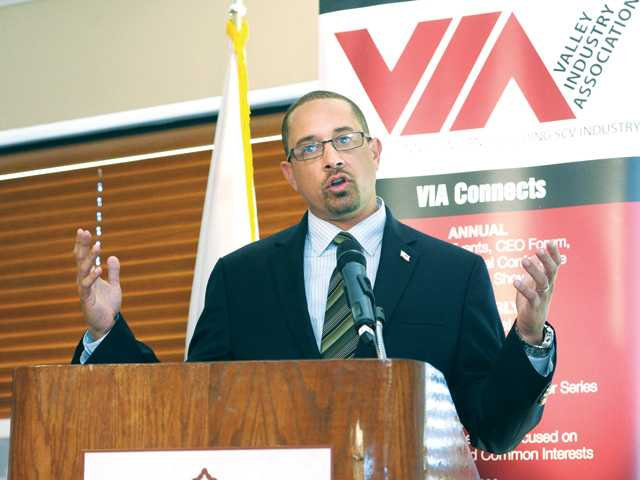 Keynote speaker Kish Rajan, director of the Governors Office of Business and Economic Development, speaks at the VIA Luncheon held at Valencia Country Club on Tuesday.