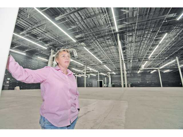 Karen Bryden, president of Santa Clarita Valley Locations, stands in Stage No. 1, which offers 30-foot celings and 56,000 feet of sound stage at Avenue Scott Stages on Tuesday.