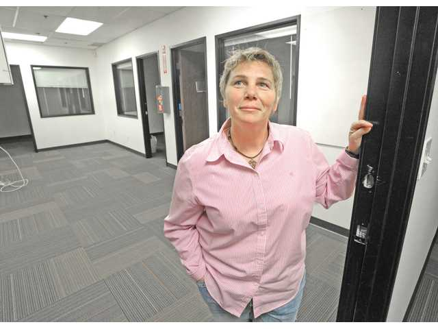 Karen Bryen, president of Santa Clarita Valley Locations, stands in post production offices at Avenue Scott Stages on Tuesday.