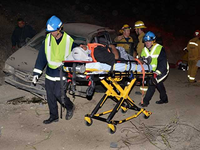 A child was transported to Henry Mayo Newhall Memorial Hospital after a single-vehicle crash on the northbound Highway 14 early this morning. Photo by Rick McClure.