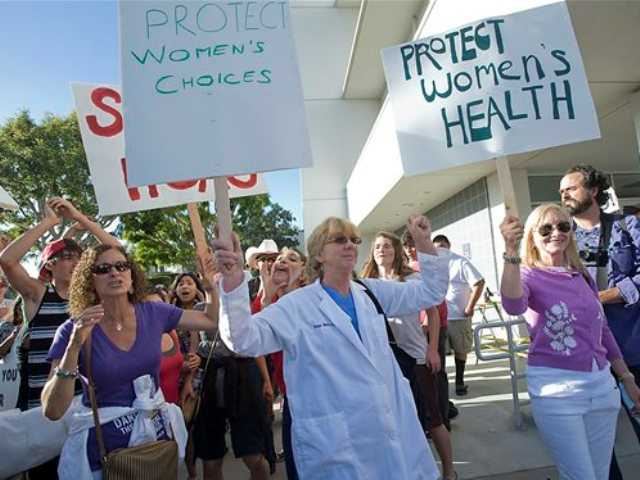 "Pro-Choice and Anti-Abortion groups faced off at a rally outside Hoag's Hospital in Newport Beach Thursday. The Pro-Choice group is protesting Hoag's Hospital decision to stop all ""direct"" abortions."