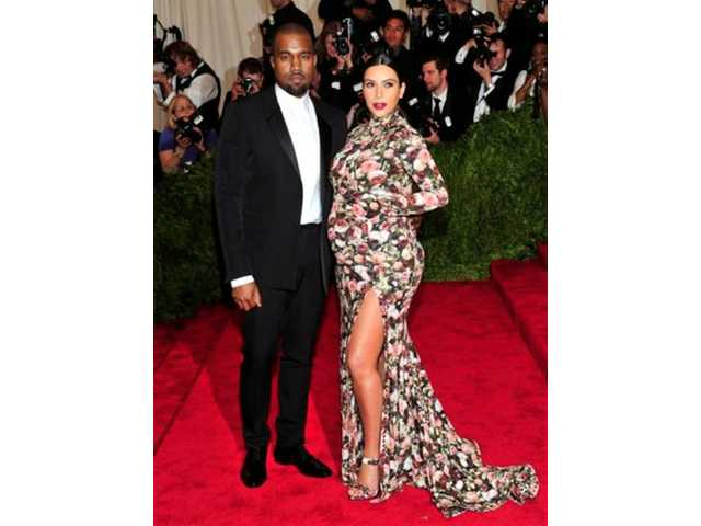 This May 6, 2013 file photo shows rapper Kanye West and Kim Kardashian attending The Metropolitan Museum of Art's Costume Institute benefit in New York. A birth certificate released by the Los Angeles County Dept. of Public Health shows that the couple's daughter North West was born on Saturday at Cedars-Sinai Medical Center in Los Angeles.