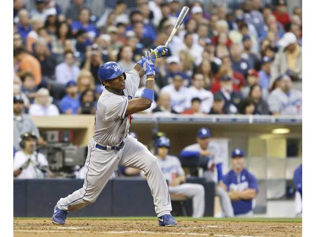 Los Angeles Dodgers' Yasiel Puig strikes out against the San Diego Padres during the third inning in San Diego on Thursday.