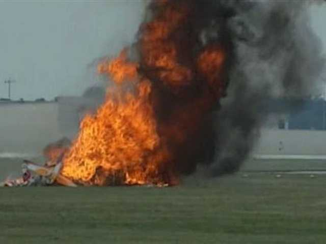 This photo provided provided WHIO TV shows a plane after it crashed today at the Vectren Air Show near Dayton, Ohio. There was no immediate word on the fate of the pilot, wing walker or anyone else aboard the plane. No one on the ground was hurt.