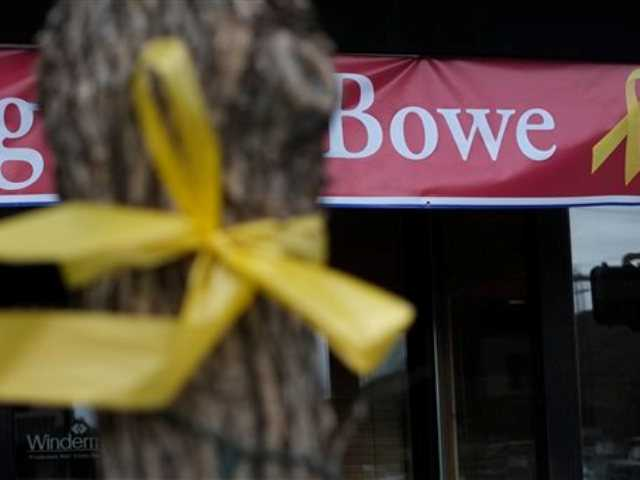 This Friday photo shows a yellow ribbon tied to a tree and a banner honoring captive U.S. Army Sgt. Bowe Bergdahl in Hailey, Idaho.