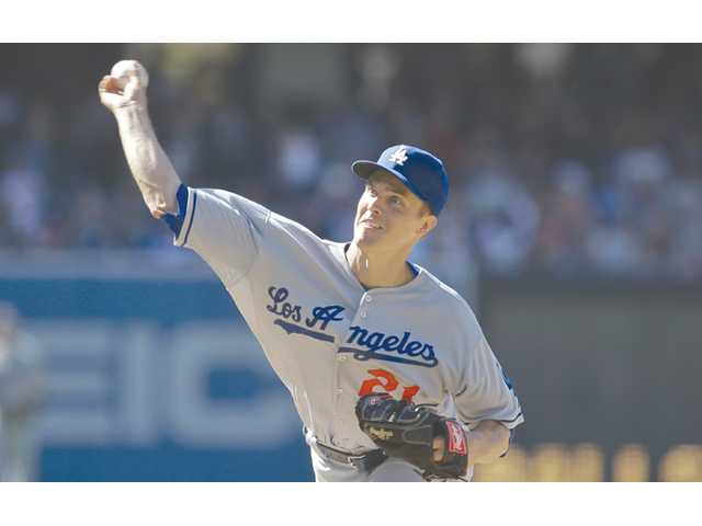 Los Angeles Dodgers starting pitcher Zack Greinke delivers against the San Diego Padres in San Diego on Saturday.