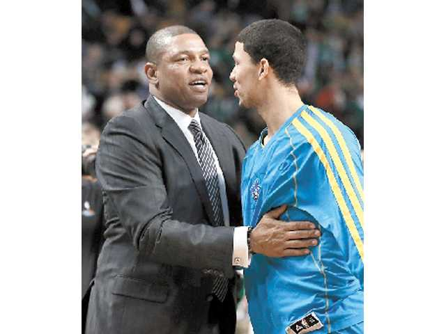 Boston Celtics head coach Doc Rivers, left, has agreed to become the next head coach of the Los Angels Clippers, pending league approval.