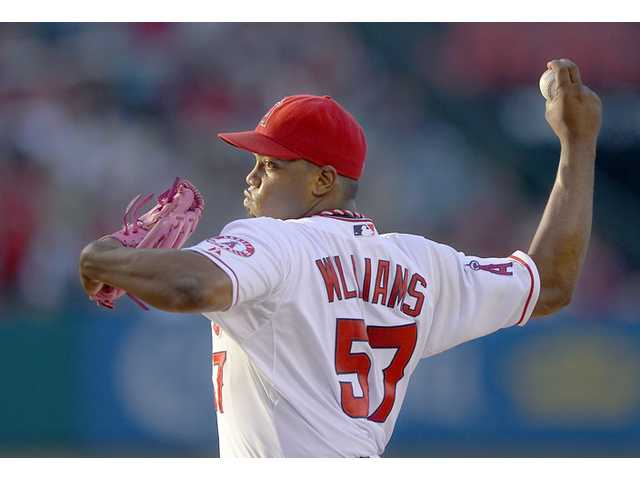 Los Angeles Angels relief pitcher Jerome Williams throws to the plate on Saturday in Anaheim.
