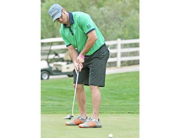 Chris Schrage watches his putt on the fourth hole at the Summer Showdown fundraiser golf tournament at Tournament Players Club Valencia on Monday. The fifth annual tournament benefits the Santa Clarita Valley Senior Center. Signal photo by Jonathan Pobre
