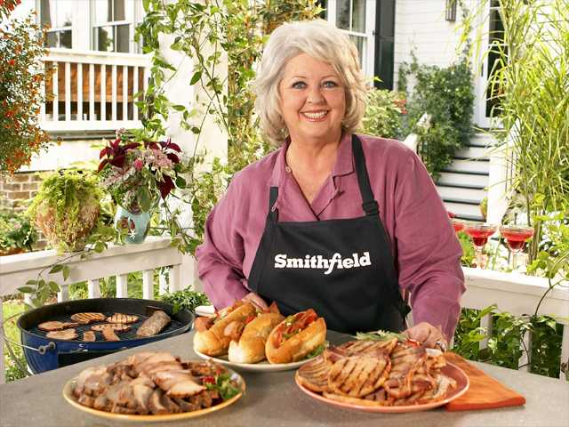 This undated image released by Smithfield Foods shows celebrity chef Paula Deen wearing a Smithfield apron as she stands in front of various Smithfield meat products. On Monday, Smithfield Foods said it was dropping Deen as a spokeswoman.