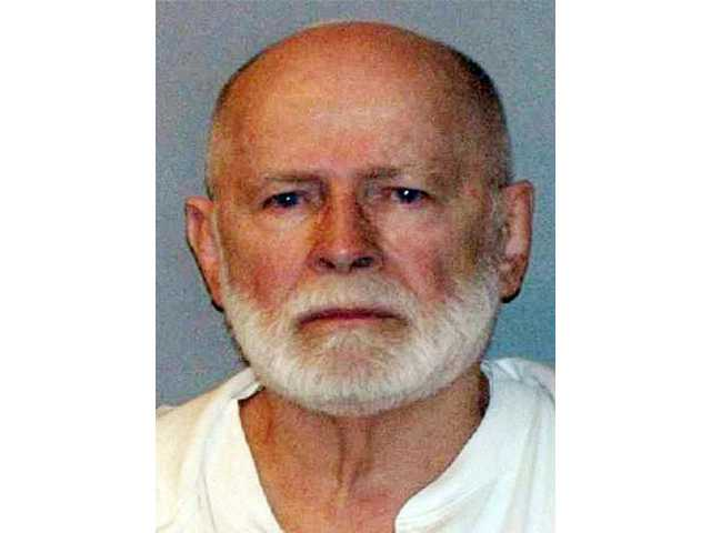 "This June 23, 2011 booking photo provided by the U.S. Marshals Service shows James ""Whitey"" Bulger, captured in Santa Monica, Calif., after 16 years on the run. Bulger's trial began Wednesday, June 12, 2013 in federal court in Boston, where he is charged with playing a role in 19 killings during the '70s and '80s."