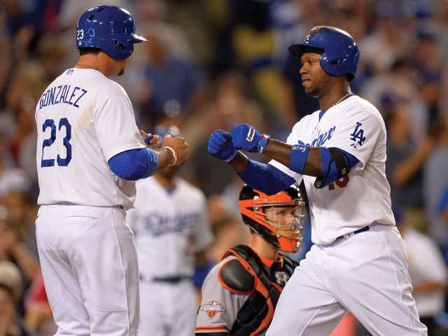 Hanley Ramirez, right, is congratulated by Adrian Gonzalez after Ramirez hit a two-run home run during the sixth inning of their baseball game against the San Francisco Giants, Tuesday, June 25, 2013, in Los Angeles.