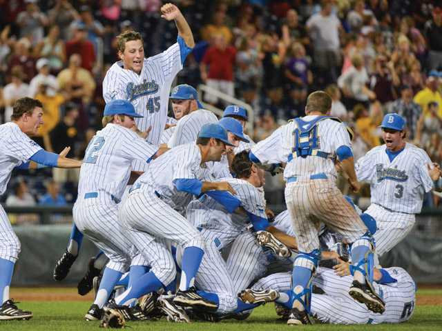 UCLA players celebrate deafeating Mississippi State 8-0 to win the championship in Game 2 of the NCAA College World Series baseball finals, Tuesday, June 25, 2013, in Omaha, Neb.