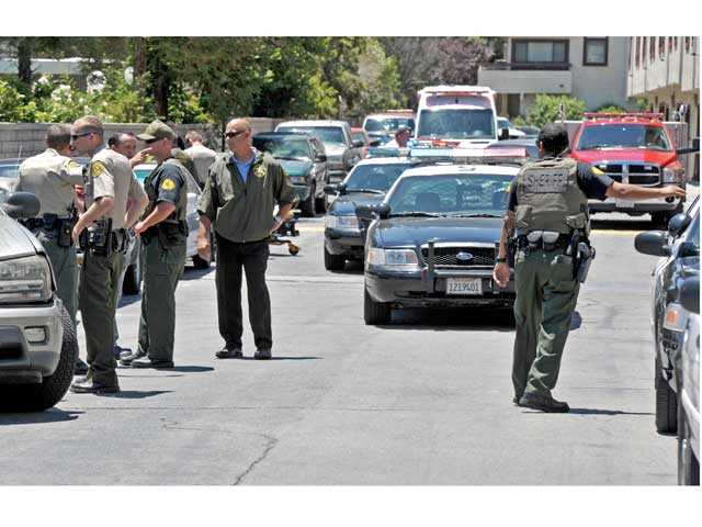 Sheriff's deputies work the scene of a reported stabbing and deputy-involved fight in the 18000 block of Sundowner Way in Canyon Country on Wednesday. Signal photo by Jonathan Pobre.