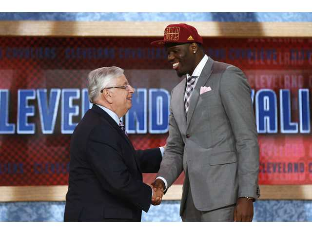 NBA Commissioner David Stern, left, shakes hands with UNLV's Anthony Bennett, who was selected first overall by the Cleveland Cavaliers in the NBA draft on Thursday in New York.