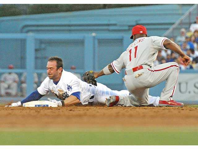 Los Angeles Dodger Nick Punto beats the tag of Phillies shortstop Jimmy Rollins to steal second base on Thursday in Los Angeles. Signal photo by Jonathan Pobre