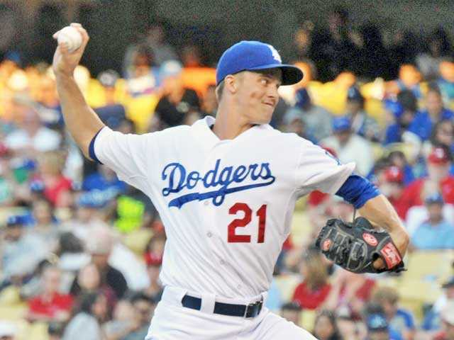 Los Angeles Dodgers starting pitcher Zack Greinke delivers against the Philadelphia Phillies on Thursday in Los Angeles. Signal photo by Jonathan Pobre