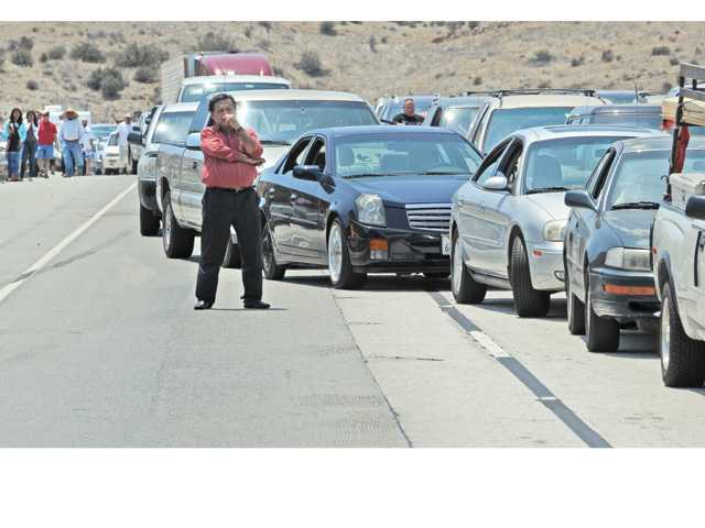 Motorists stand outside of their cars as they wait for a crash on the northbound Highway 14 Freeway, south of Agua Dulce Canyon Road to clear on Saturday afternoon in Agua Dulce. Signal photo by Dan Watson.