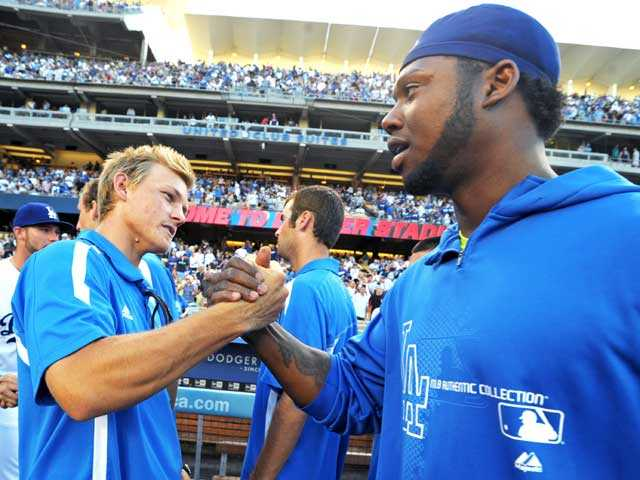 Hart graduate Pat Valaika, left, meets Los Angeles Dodger Hanley Ramirez prior to the Dodgers game against the Phillies on Thursday at Dodger Stadium. Valaika and the Bruins were honored for winning the NCAA Division I College World Series.