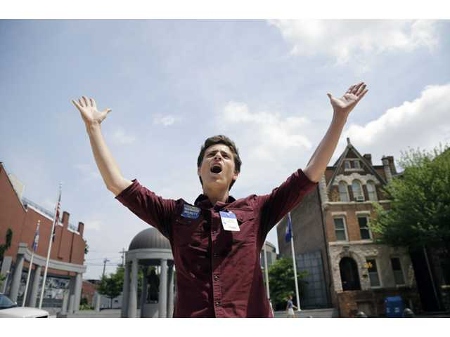 Christian Olivera, of Newark, N.J., shouts toward the Statehouse in Trenton, N.J. on Thursday, June 27, 2013 as he and other advocates for gay marriage in New Jersey gather, saying they'll press their case in the legislature and the courts after the U.S. Supreme Court ruling.