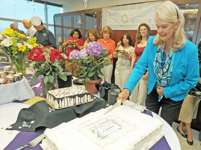 College of the Canyons Chancellor Dianne G. Van Hook cuts a cake marking 25 years of service to the college during a University Center ceremony on the Valencia campus Monday. Photo by Jonathan Pobre