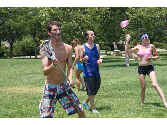 "Members of the ""blue coats"" battle during the Water Balloon Revolution held at Valencia Valley Park on Sunday."