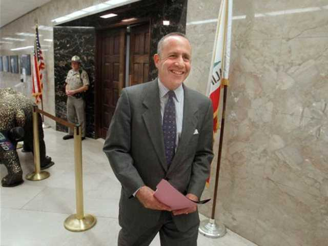 Senate President Pro Tem Darrell Steinberg, D-Sacramento, smiles as he leaves the Governor's office after a budget meeting with Gov. Jerry Brown and Assembly Speaker John Perez, D-Los Angeles, in Sacramento, Monday.