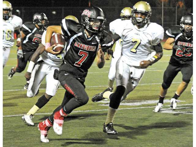 Santa Clarita Christian quarterback Jonathan Saavedra and the Cardinals' football team rallied late to finish 7-3 in 2012.