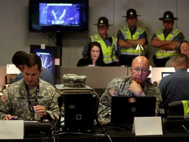 Law enforcement officials monitor surveillance cameras as part of an increased security effort for the Independence Day celebration, the first major public gathering since the Boston Marathon bombings, at the Unified Command Center, today in Boston.