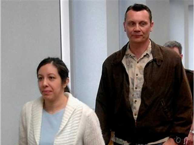 In this May 7, 2008 file photo, Leilani and Dale Neumann leave a Marathon County Circuit Courtroom in Wausau, Wis. Today, the Wisconsin Supreme Court ruled that the mother and father who prayed instead of seeking medical help as their 11-year-old daughter Madeline Kara Neumann died in front of them were properly convicted of homicide.