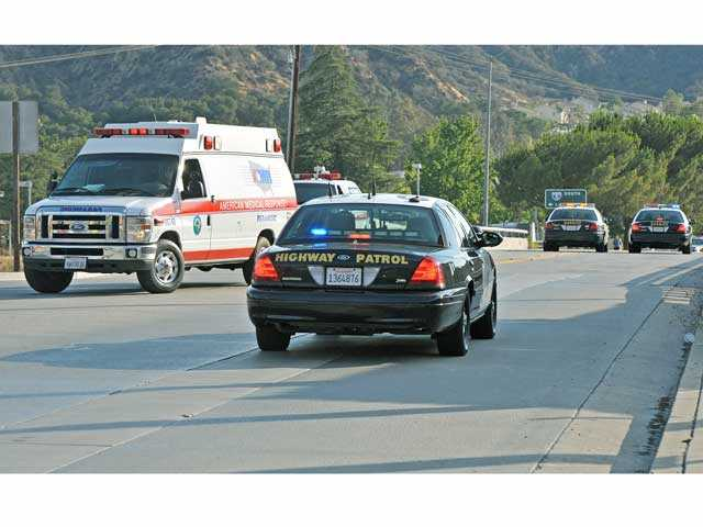 An ambulance and law enforcement vehicles prepare to leave the scene where a man threatened to jump off the Parker Road overpass over Interstate 5 in Castaic on Wednesday. Signal photo by Jonathan Pobre