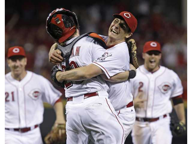 Cincinnati Reds starting pitcher Homer Bailey, right, hugs catcher Ryan Hanigan, left, after Bailey threw a no-hitter on Tuesday in Cincinnati.