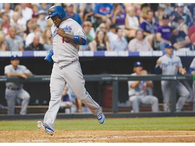 Los Angeles Dodger Hanley Ramirez scores on a single by A.J. Ellis against the Colorado Rockies in Denver on Wednesday.