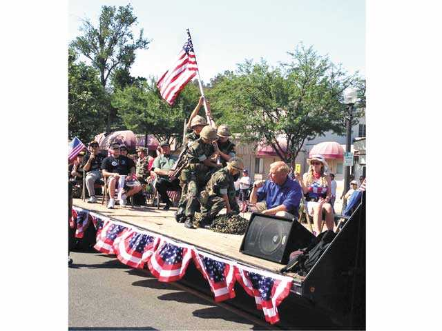 The Prayer Angels for the Military float won the Sweestakes trophy at the 2013 Santa Clarita Valley Fourth of July Parade for its re-enactment of the raising of the flag in Iwo Jima. Photo courtesy of Laura Hauser