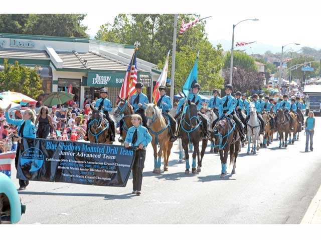 The Blue Shadows Mounted Drill Team won the Grand Equestrian trophy at the 2013 Santa Clarita Valley Fourth of July Parade on Thursday. Signal photo by Dan Watson