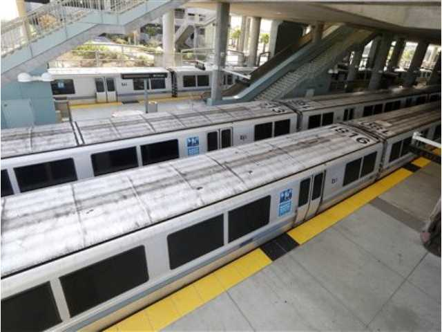 Bay Area Rapid Transit trains are shown sitting on the platform at the station in Millbrae, Calif., Monday, July 1, 2013.