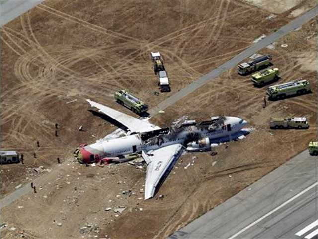 This aerial photo shows the wreckage of the Asiana Flight 214 airplane after it crashed at the San Francisco International Airport in San Francisco today.