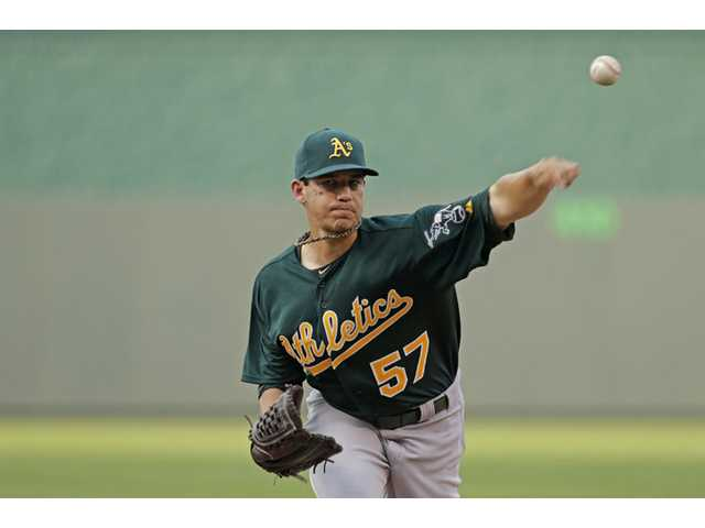 Oakland Athletics starting pitcher and Saugus graduate Tommy Milone throws during the first inning against the Kansas City Royals on Friday in Kansas City, Mo.