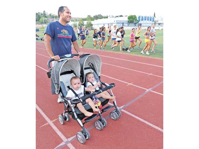 With newborn twins time management was crucial for Saugus girls cross country head coach Rene Paragas this season. But he managed put everything together and lead the Centurions to a seventh straight CIF State cross country championship.