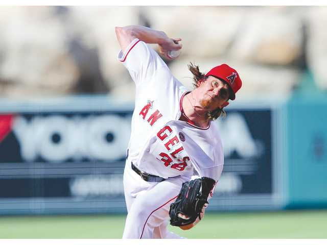 Los Angeles Angels pitcher Jered Weaver delivers in the first inning against the Boston Red Sox on Sunday in Anaheim.