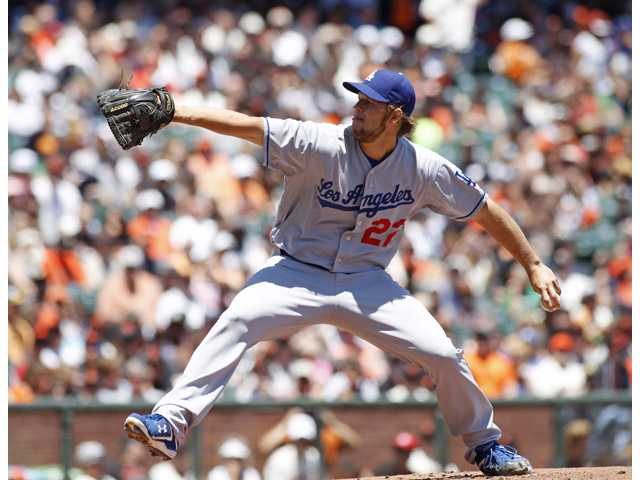 Los Angeles Dodgers pitcher Clayton Kershaw throws to the San Francisco Giants in San Francisco on Sunday.