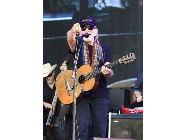 Willie Nelson performs at the Oklahoma Twister Relief Concert at the Gaylord Family-Oklahoma Memorial Stadium on Saturday in Norman, Okla.