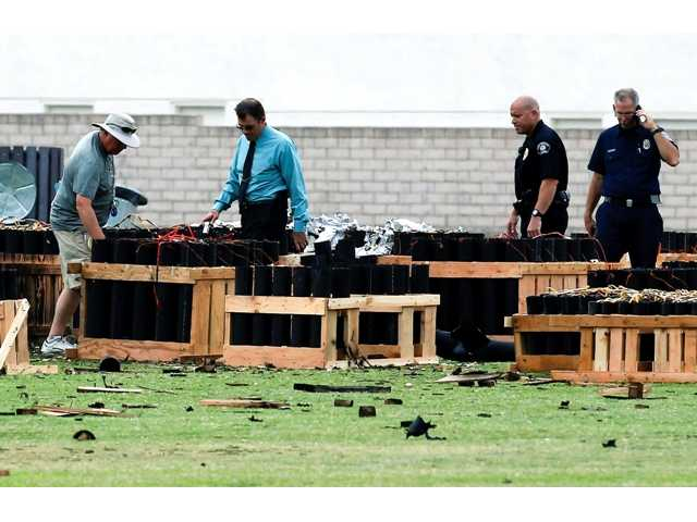 Police officials investigate the site of a fireworks explosion in Simi Valley, Calif., Friday July 5. The display operator suspects a product malfunction.