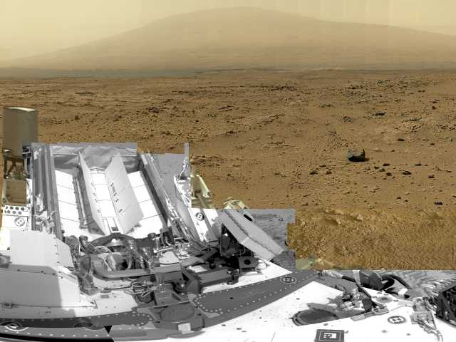 Nearly a year after landing, Curiosity is finally starting the drive to a mountain in search of the chemical building blocks of life. In this photo the rover shows Gale Crater.